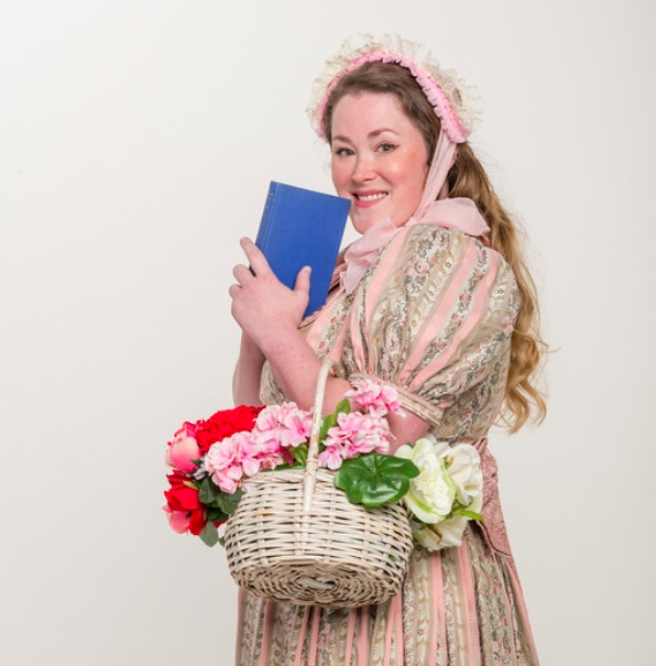 uploads/headshots/ruddigore-gilbert-sullivan-austin-2018-photoshoot/corinna_browning_with_book.jpg