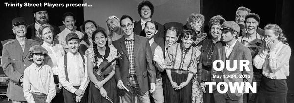 Scot Friedman surrounded by the cast (photo: Trinity Street Players)